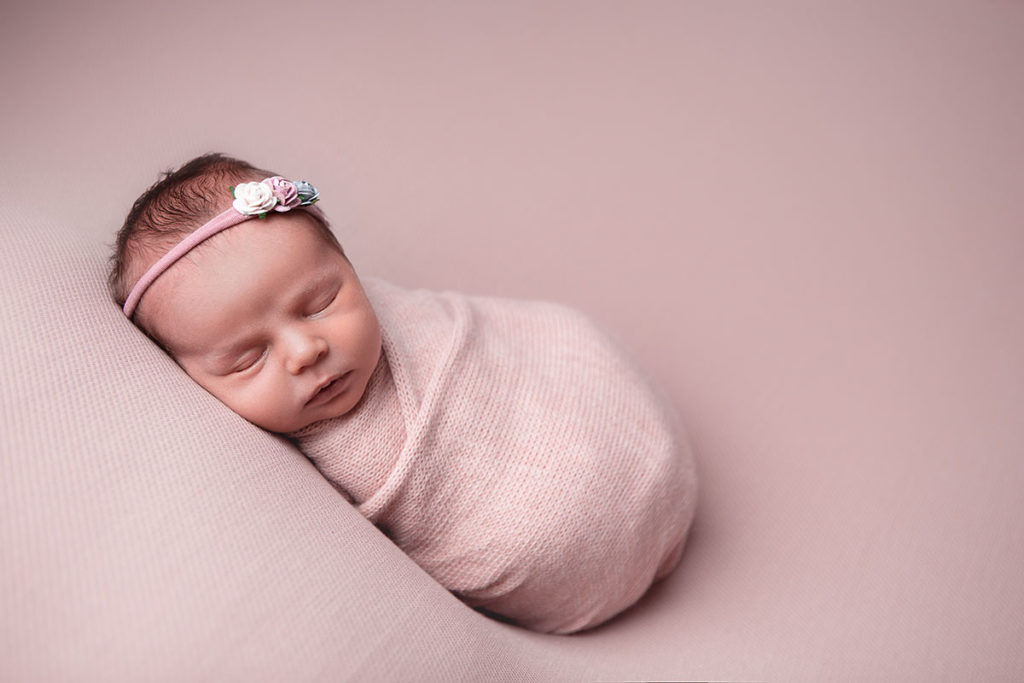 Which photos do you take during a newborn photography session?
